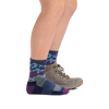 Profile image of kid legs facing to the right wearing Kids Three Peaks Micro Crew Lightweight Hiking Sock in Denim with rear foot in a hiking boot