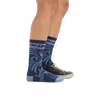 Profile image of a woman wearing Women's Vines Crew Lightweight Lifestyle Socks in Denim with a casual shoe on one foot