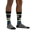 Man standing barefoot wearing Icefields Crew Lightweight Lifestyle Sock in Gray