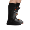 Profile of male legs facing right wearing Edge Over the Calf Lightweight Ski & Snowboard in Black with back foot in a ski boot