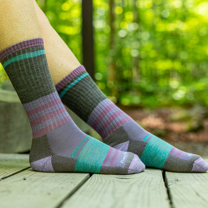 Close up image of a woman's feet outside, wearing Women's Her Spur Boot Lightweight Hiking Socks in Taupe, Lifestyle Image