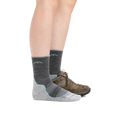Profile image of a woman's legs on a white background wearing Women's Light Hiker Micro Crew Lightweight Hiking Socks in Slate with one foot also in a hiking shoe