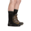 Profile image of legs on a white background, facing right, wearing Hunter Boot Midweight Hunting Socks in Charcoal and rear foot also wearing a hunting boot
