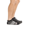 Profile of male legs wearing  1437 No Show Athletic Sock in charcoal and back foot wearing a sneaker