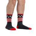 Man standing barefoot wearing Patriot Micro Crew Ultra-Lightweight Running Socks in Stars and Stripes
