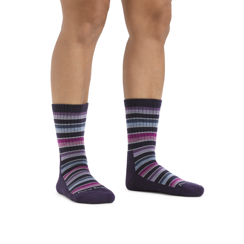Image of a woman's legs on a white background wearing Women's Decade Stripe Micro Crew Midweight Hiking Socks in Blackberry
