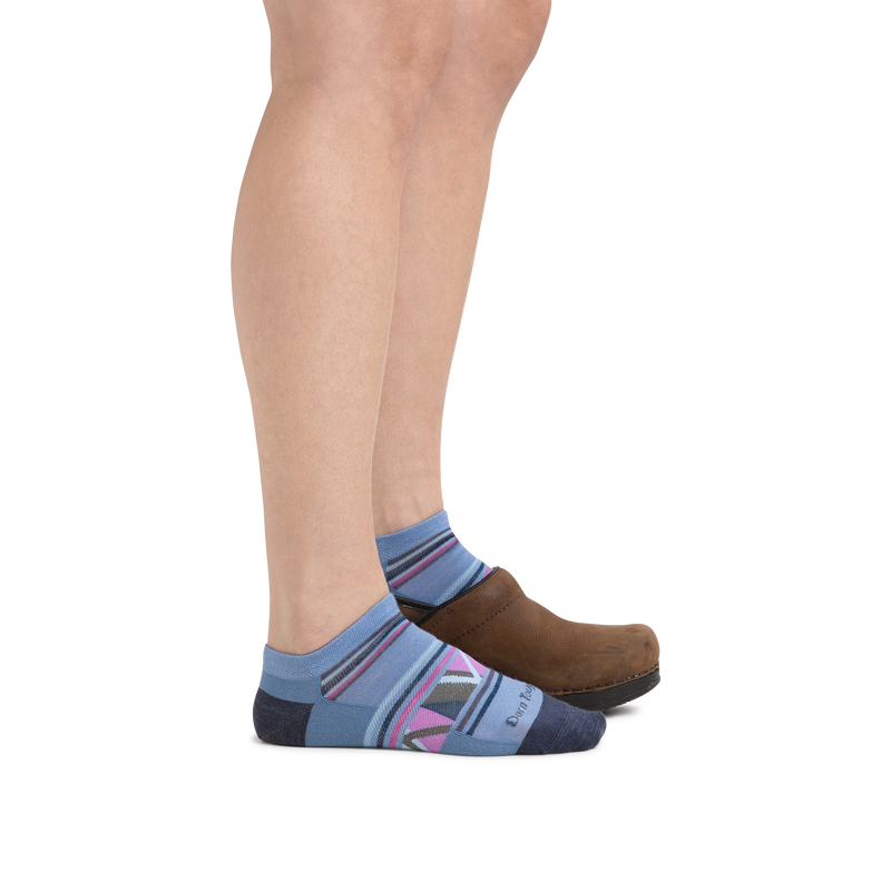 Profile image of a woman's legs on a white background wearing Women's Bridge No Show Lightweight Lifestyle Socks in Blue with back foot also in a clog