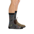 Man standing facing to the right wearing Pop McFly Crew Lightweight Lifestyle Sock in Gray with foot in back also wearing a casual boot