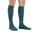 Image of a woman's legs on a white background wearing Women's Sea to Sky Over the Calf Lightweight Ski & Snowboard Socks in Teal