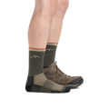 Profile image of a man's legs facing right against a white background wearing Hunter Micro Crew Midweight Hunting Socks in Forest with back foot also in a hunting boot