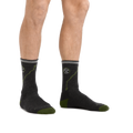 Man standing barefoot wearing ATC Micro Crew Hiking Socks in Charcoal