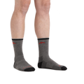 Man standing barefoot wearing Coolmax Hiker Micro Crew Hiking Socks in Gray/Black