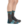 Profile image of a woman's legs on a white background, facing to the right, wearing Women's Bear Town Micro Crew Lightweight Hiking Socks in Aqua with back foot also in a hiking shoe