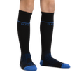 Kid standing barefoot on a white background wearing Kids RFL Over the Calf Ultra-Lightweight Ski & Snowboard Sock in Black