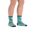 Kid standing barefoot wearing Lazy Daze Micro Crew Lightweight Hiking Socks in Aqua