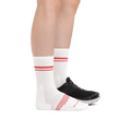 Profile image of a woman's legs on a white background facing to the right, wearing Women's Element Crew Lightweight Athletic Socks in White and an athletic shoe on one foot