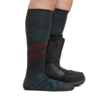 Profile of male legs standing facing to the right wearing Pennant RFL Over the Calf Ultra-Lightweight Ski & Snowboard socks in Charcoal with back foot also in a snowboard boot