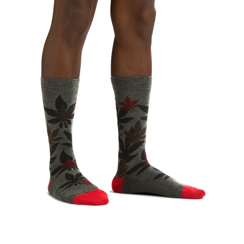 Man standing barefoot wearing Haze Crew Lightweight Lifestyle Socks in Forest
