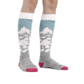 Image of a woman's legs on a white background, wearing Women's Yeti Over the Calf Ski & Snowboard Socks in Glacier