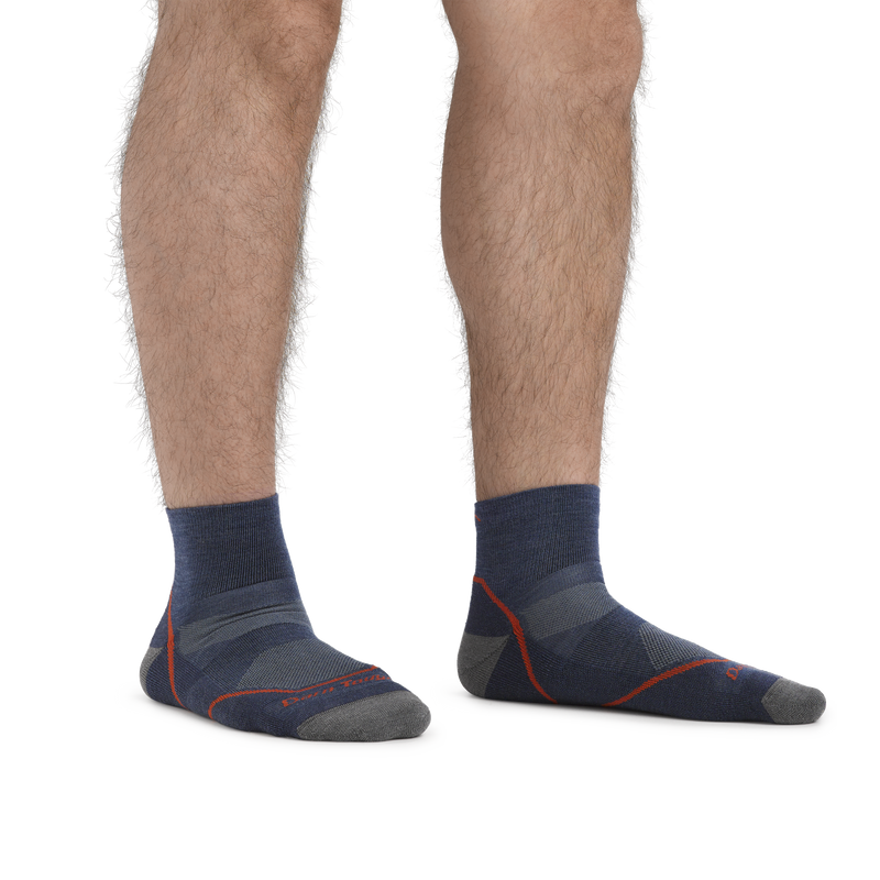 Man standing barefoot wearing Light Hiker Quarter Lightweight Hiking Socks in Denim