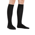 Image of a woman's legs on a white background wearing Women's Solid Basic Knee High Lightweight Lifestyle Socks in Black