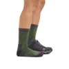 Profile image of a woman's legs, facing right on a white background, wearing Women's Hiker Micro Crew Midweight Hiking Socks in Moss Heather and one foot wearing a sneaker