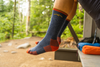 Backpacker sitting in hammock wearing merino wool darn tough socks style 1403, the men's hiker boot sock in denim, Lifestyle Image