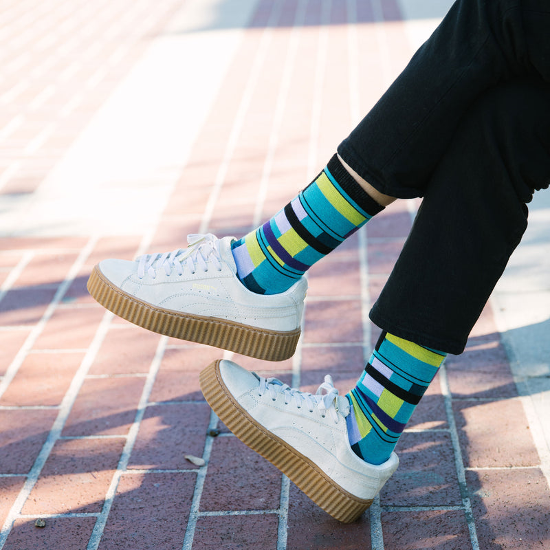 Close up image of a woman wearing white sneakers and black pants while also wearing Women's Alexa Crew Lightweight Lifestyle Socks in Teal, Lifestyle Image