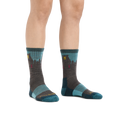 Image of a woman's feet on a white background, wearing Women's Bear Town Micro Crew Lightweight Hiking Socks in Aqua