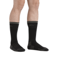 Image of legs on a white background, facing right, wearing Hunter Boot Midweight Hunting Socks in Charcoal