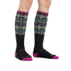 Image of a woman's legs on a white background wearing Women's Northstar Over the Calf Midweight Ski & Snowboard Socks in Black