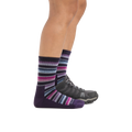 Profile image of a woman's legs on a white background, facing to the right, wearing Women's Decade Stripe Micro Crew Midweight Hiking Socks in Blackberry and the back foot also wearing a hiking shoe