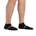 Man standing barefoot wearing Element No Show Tab Lightweight Athletic Socks with Cushion in Black