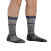 Man standing barefoot wearing Frequency Crew Lightweight Lifestyle Socks in Gray