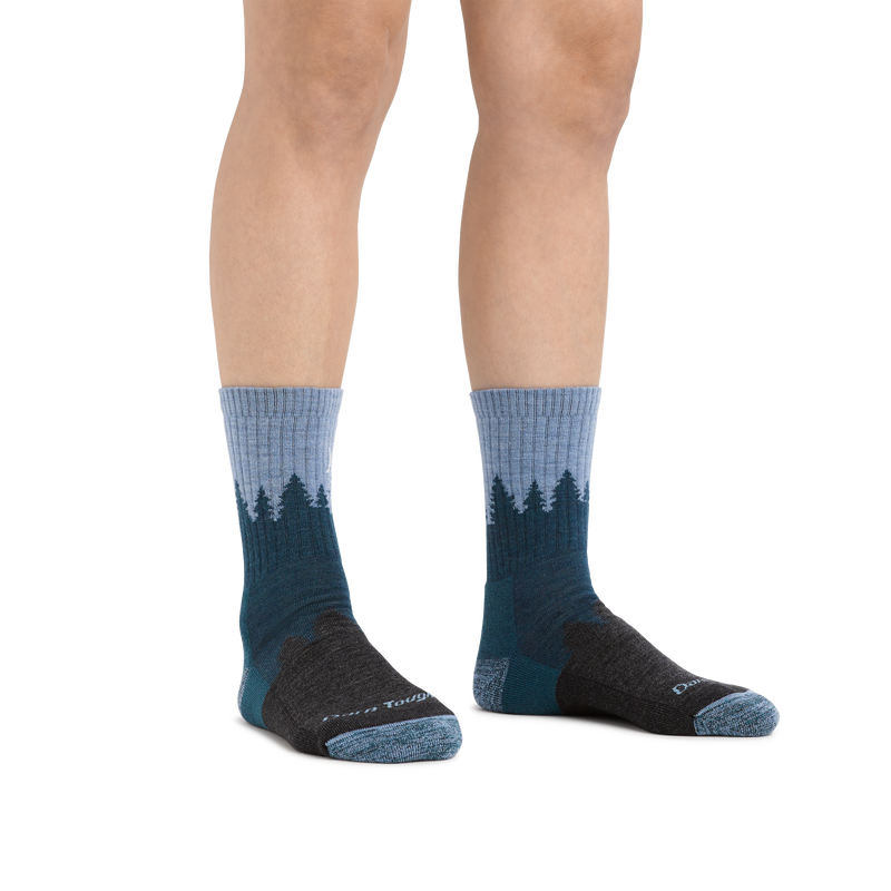 Image of a woman's legs on a white background wearing Women's Treeline Micro Crew Midweight Hiking Socks in Blue