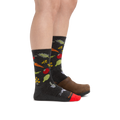 Profile image of a woman's legs, facing to the right, wearing Women's Farmer's Market Crew Lightweight Lifestyle Socks in Charcoal with the back foot also in a clog