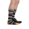 Profile of male legs facing right wearing Oxford Crew Lightweight Lifestyle Socks in Gray, with back foot in a dress shoe