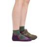 Profile image of a woman's legs on a white background, facing right, wearing Women's Light Hiker Quarter Lightweight Hiking Socks in Moss Heather with a hiking boot on one foot