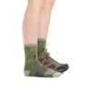 Profile image of a woman's legs, facing right, wearing Women's Queen Bee Micro Crew Lightweight Hiking Socks in Willow and one foot in a hiking shoe