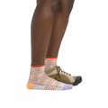 Profile image of a woman's legs on a white background, facing right, wearing Women's Picnic Shorty Lightweight Lifestyle Socks in Ash with a casual shoe on one foot