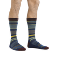 Man standing barefoot wearing Unstandard Stripe Crew Lightweight Lifestyle Sock in Denim