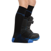 Profile image of kid legs facing to the right on a white background wearing Kids RFL Over the Calf Ultra-Lightweight Ski & Snowboard Sock in Black with rear foot also in a snowboard boot