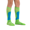 Kid standing barefoot wearing Fall Line Over the Calf Lightweight Ski & Snowboard Socks in Green