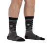 Waist down image of man barefoot, wearing Derby Crew Lightweight Lifestyle Socks in Gray