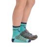Profile of kid legs facing to the right wearing Lazy Daze Micro Crew Lightweight Hiking Socks in Aqua with the rear foot also in a hiking shoe