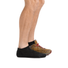 Profile of male legs facing to the right wearing Light Hiker No Show Lightweight Hiking Socks in Black and back foot also in a hiking boot