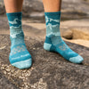 Close up image of a woman's bare feet on a rock, wearing Women's Three Peaks Micro Crew Lightweight Hiking Sock in Teal, Lifestyle Image