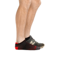 Profile of male legs facing right, front foot wearing Run No Show Tab Ultralightweight Running Socks in Burgundy and the back foot also wearing an athletic sneaker
