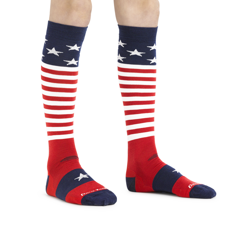 Kid standing barefoot wearing Captain Stripes Over the Calf Lightweight Ski & Snowboard in Stars and Stripes