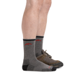 Man standing facing right, front foot wearing only Coolmax Hiker Micro Crew Hiking sock, and back foot wearing the sock and a hiking shoe, showing the height of the sock comes above the top of the shoe to about mid-calf
